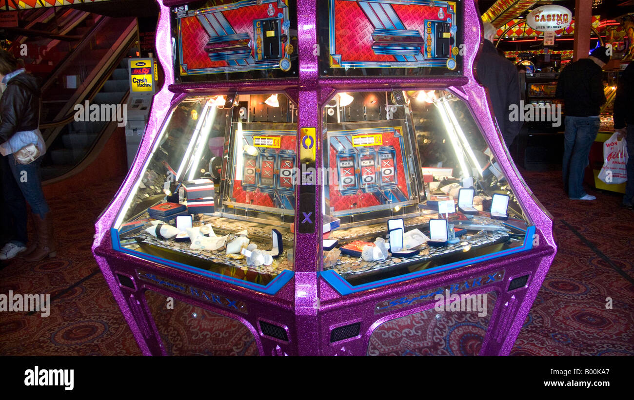 Penny falls machine in an amusement arcade, Scarborough Stock Photo