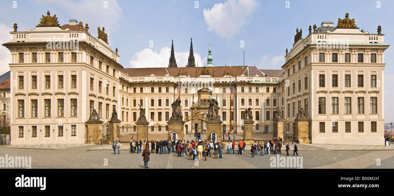 A 2 picture panoramic stitch of the main Entrance to Prague castle with tourists watching the 'changing of the - Stock Image