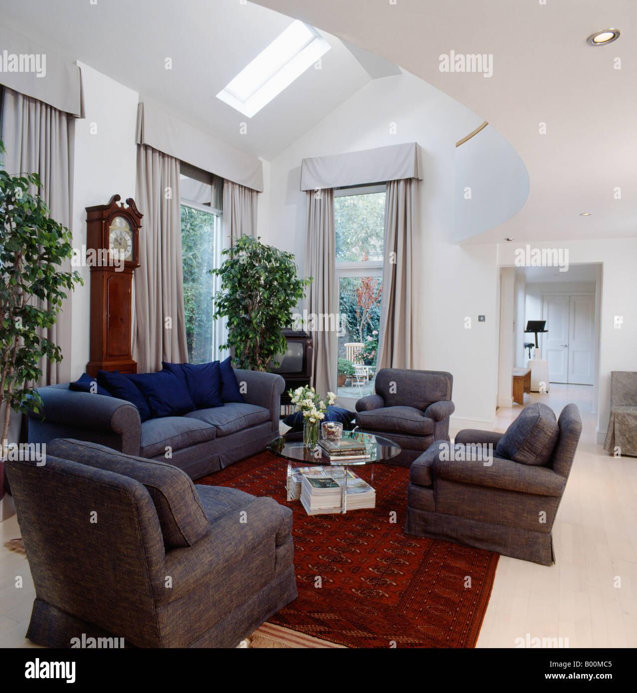 Grey Armchairs And Red Oriental Rug In Eighties Living Room