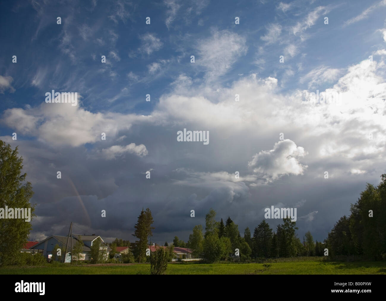 Thunderstorm clouds rising over a residential area , Finland - Stock Image