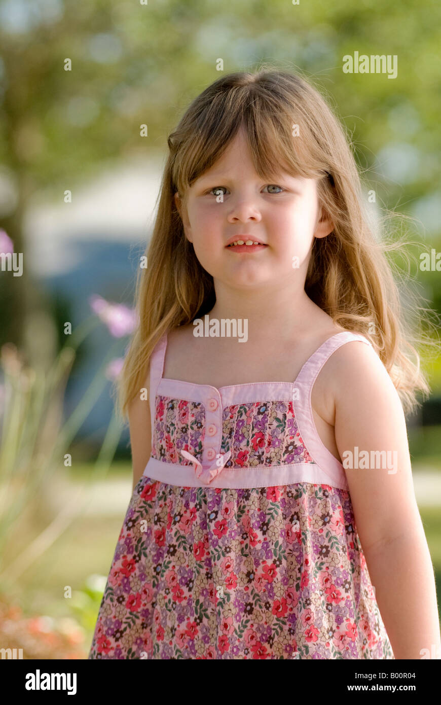 Four Year Two Year Community: 4 Year Old Little Girl In Park With Pensive Look Stock