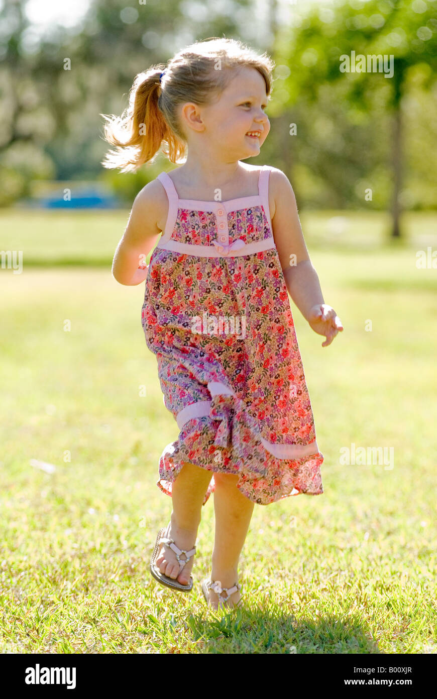 Four Year Two Year Community: Little 4 Year Old Girl Running In The Park In Sun Dress