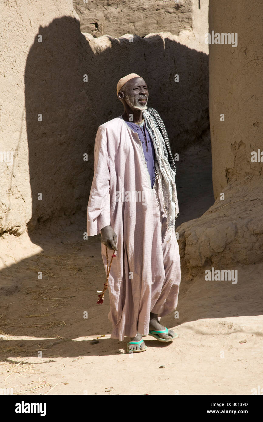 Mali, Niger Inland Delta. An old man walks through the ...
