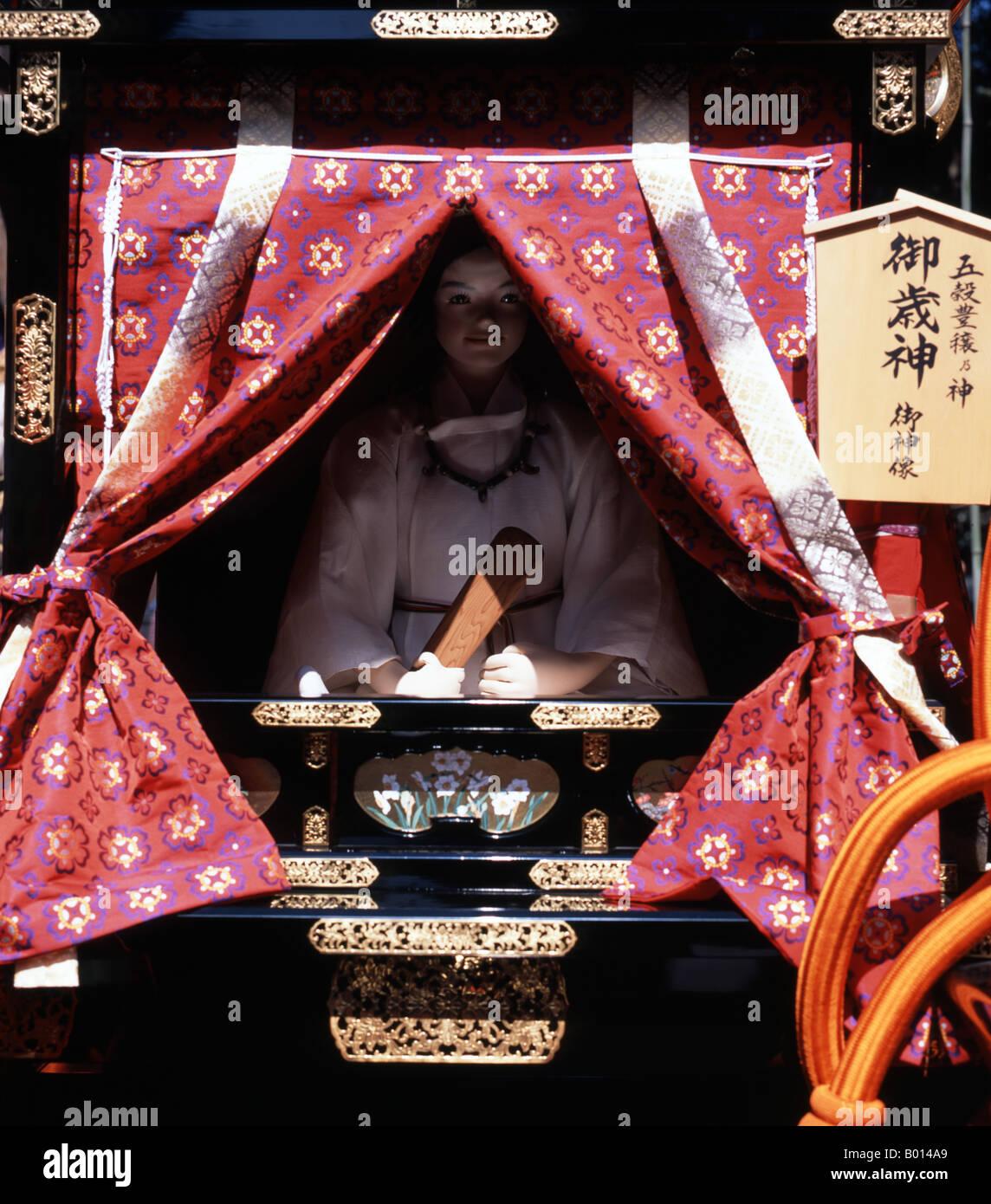 Princess doll inside mikoshi ( portable shrine ) at Honensai Festival, Tagata Shrine, Nagoya, Japan - Stock Image