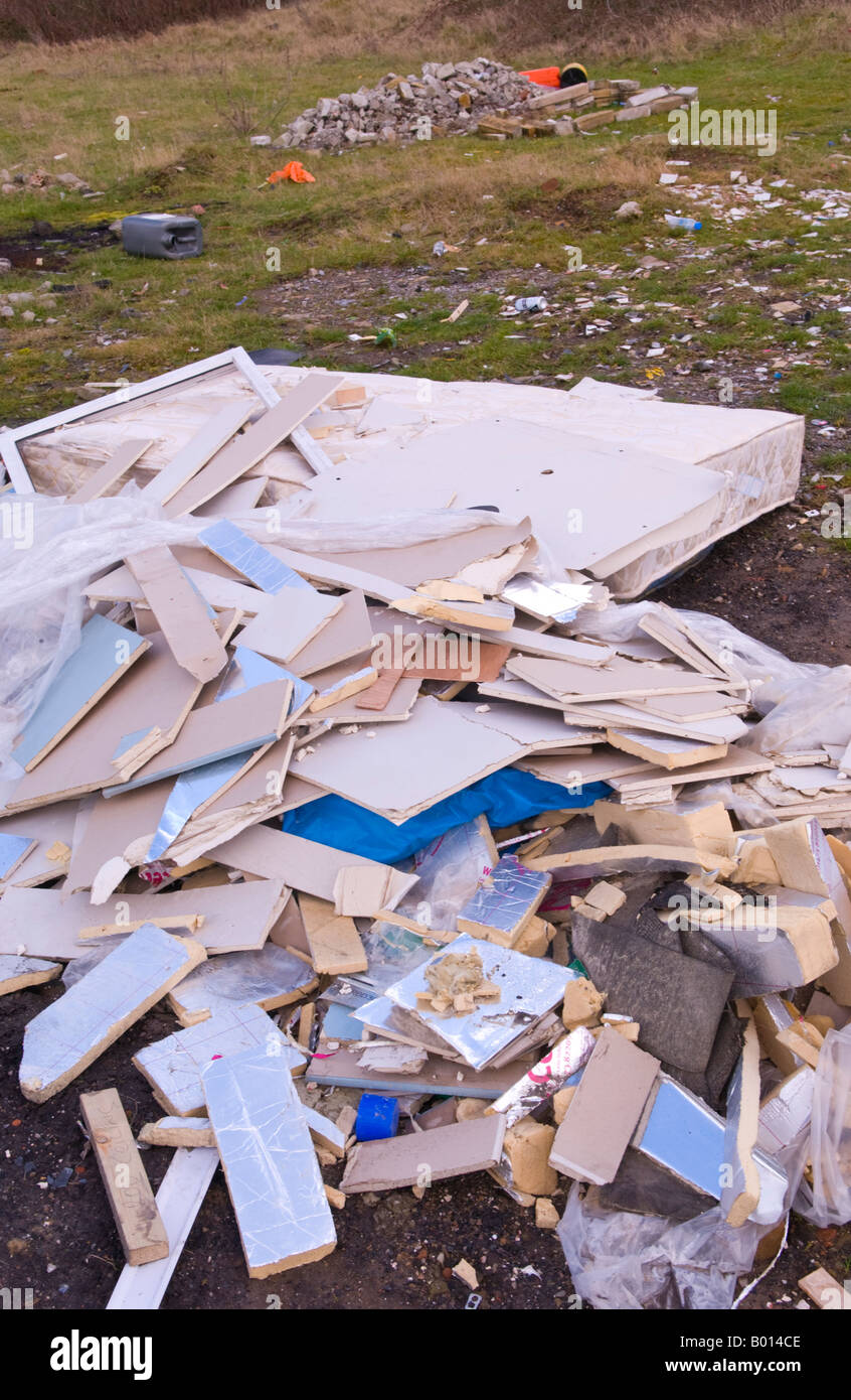 Builders rubble and domestic household waste dumped in countryside in Torfaen South Wales UK EU - Stock Image
