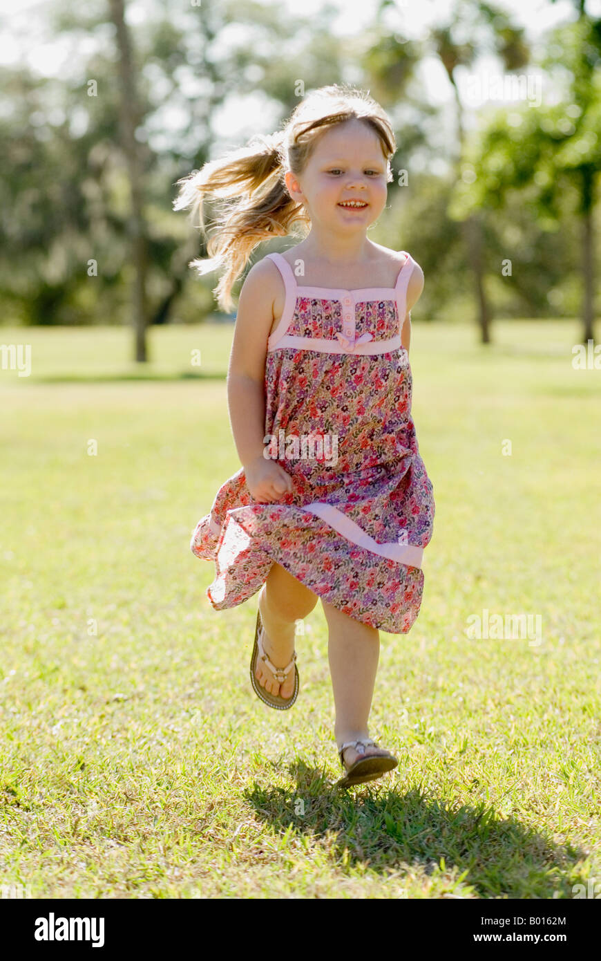 7d8e2a2837 Happiness is a run in the park little girl in sun dress running in park with