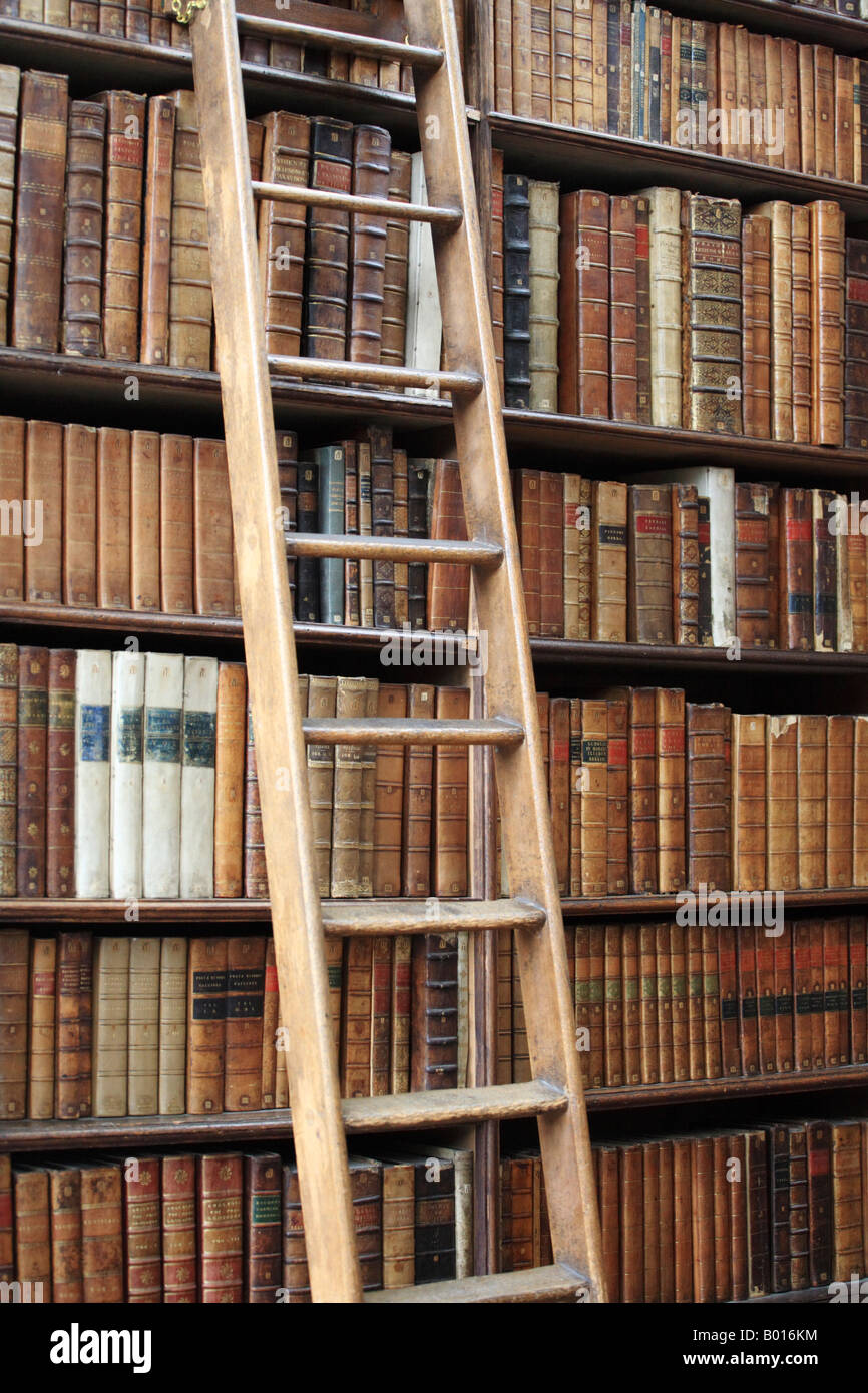 Ladder Propped Up Against A Bookshelf Full Of Old Books In Wren Library Trinity College Cambridge University