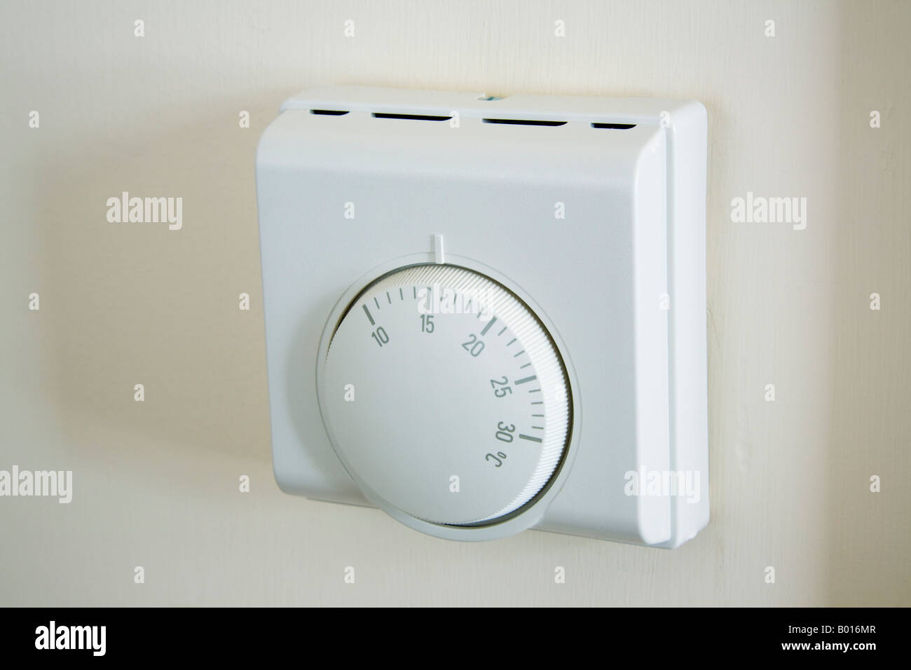 Britain UK Central heating thermostat wall mounted set at low Stock ...