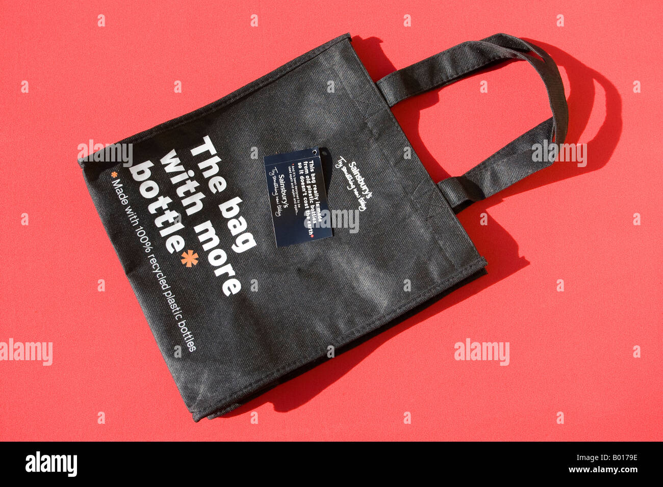 Reuse shopping bags made from old plastic bottles Sainsburys supermarket Cheltenham UK - Stock Image