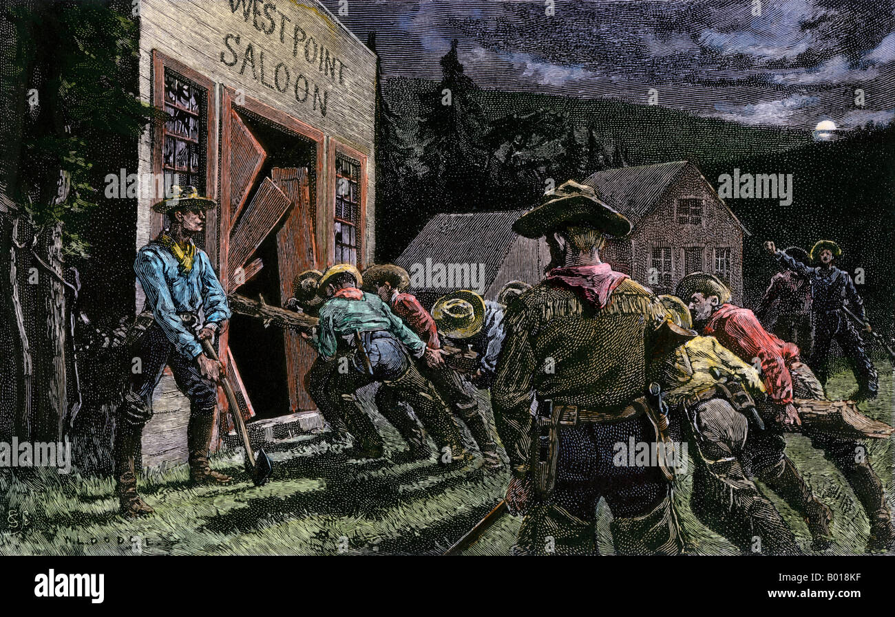Western miners smashing into a saloon. Hand-colored woodcut - Stock Image