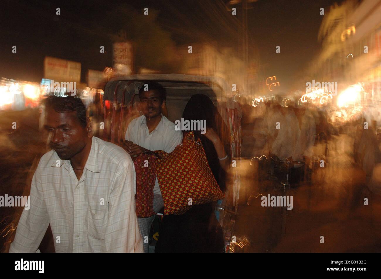 Indian rickshaw rider with passenger at night, Varansi Stock Photo