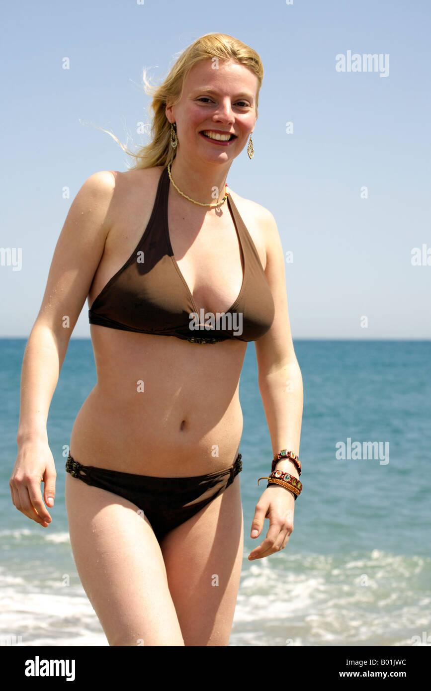 600e536d0eaf11 Young woman in the Mediterranean Sea, Fuengirola beach, Costa del Sol, Spain