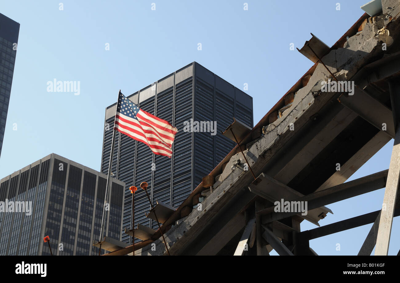 At ground zero in Lower Manhattan, a U. S flag. flies over the survivors staircase, a remnant of the World Trade - Stock Image