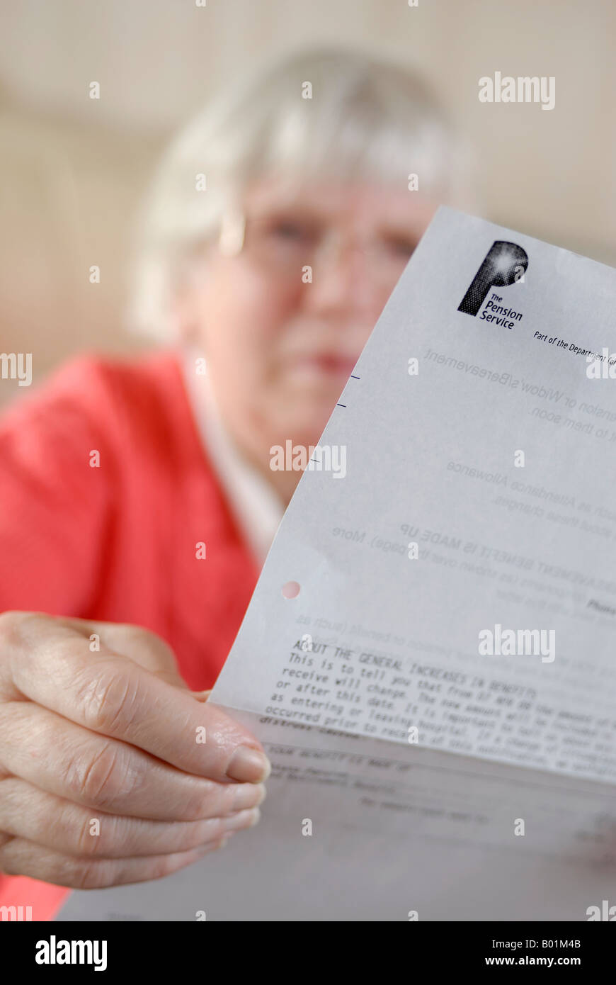 Mature woman with Pension statement - Stock Image