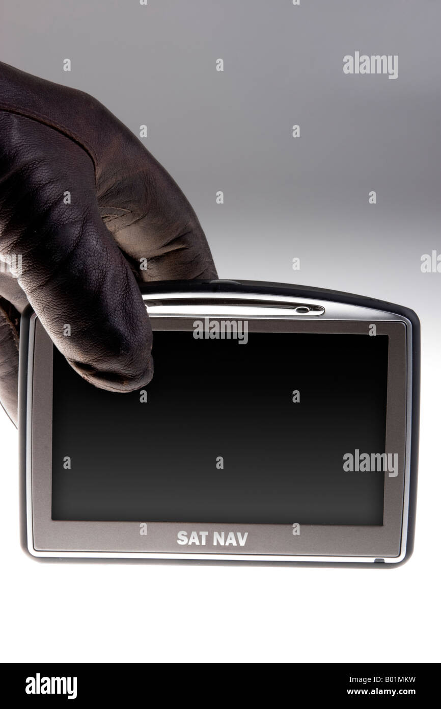 Gloved hand stealing a satellite navigation unit - Stock Image