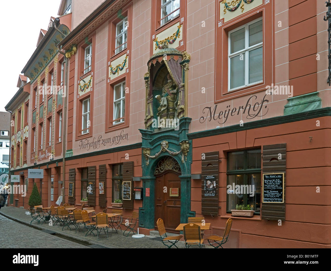 inn restaurant in an old baroque house Wirtschaft zum großen Meyerhof Street lane in the old town of Freiburg - Stock Image