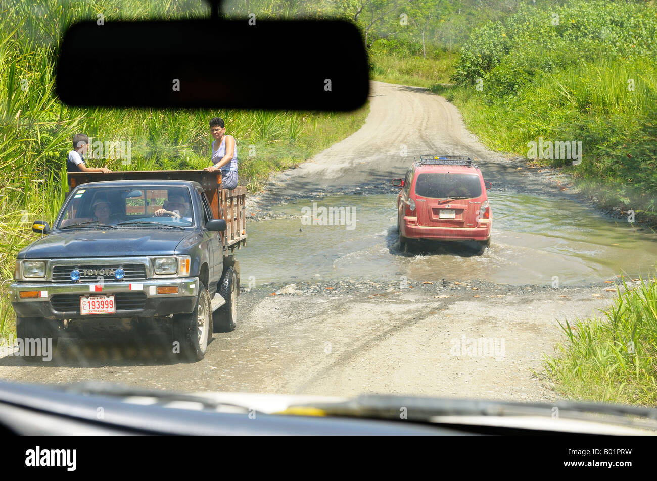 Taxis fording a stream on the Puerto Jimenez to Carate road in Costa Rica - Stock Image