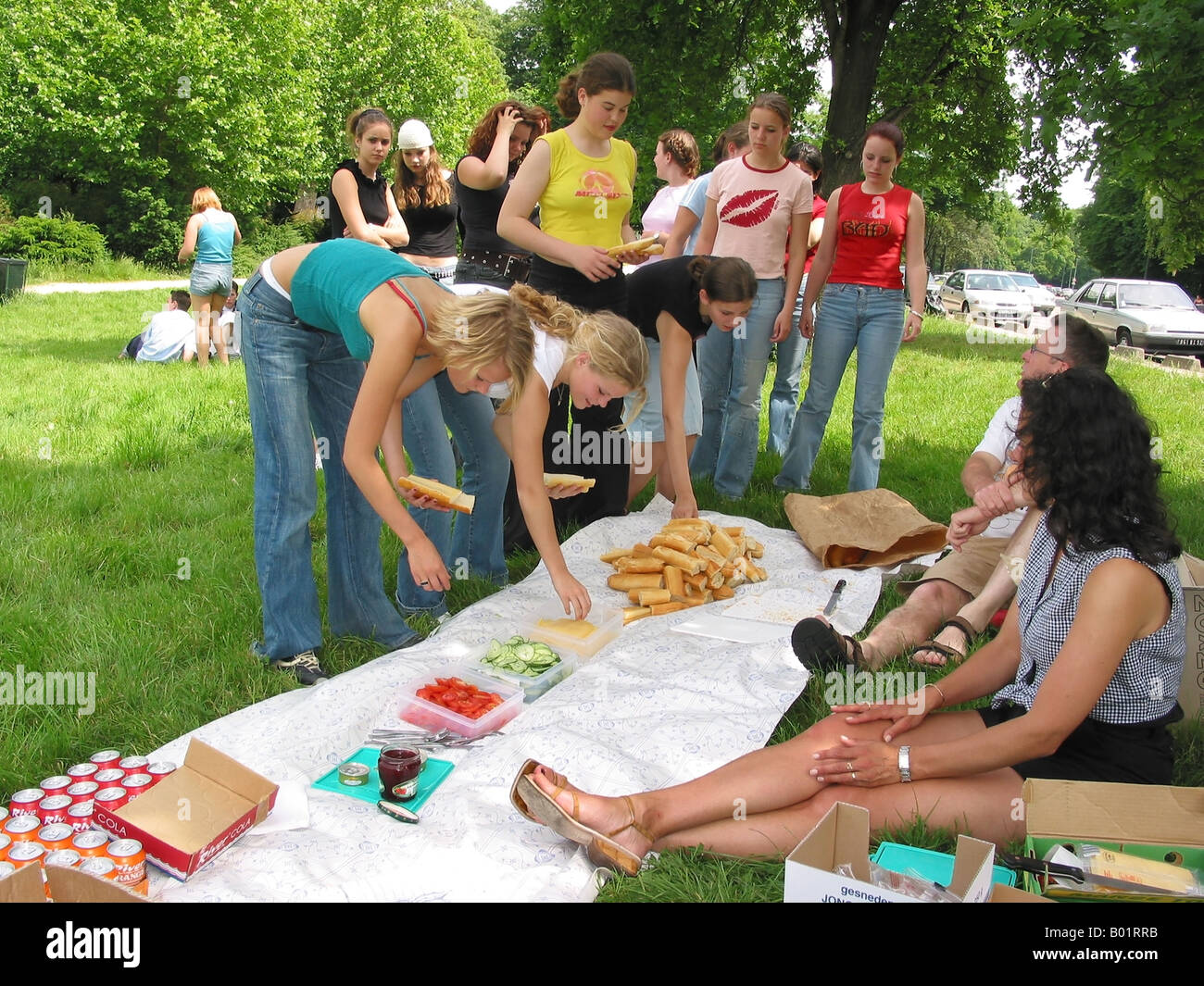 picnic in the park on a school trip to Paris France - Stock Image