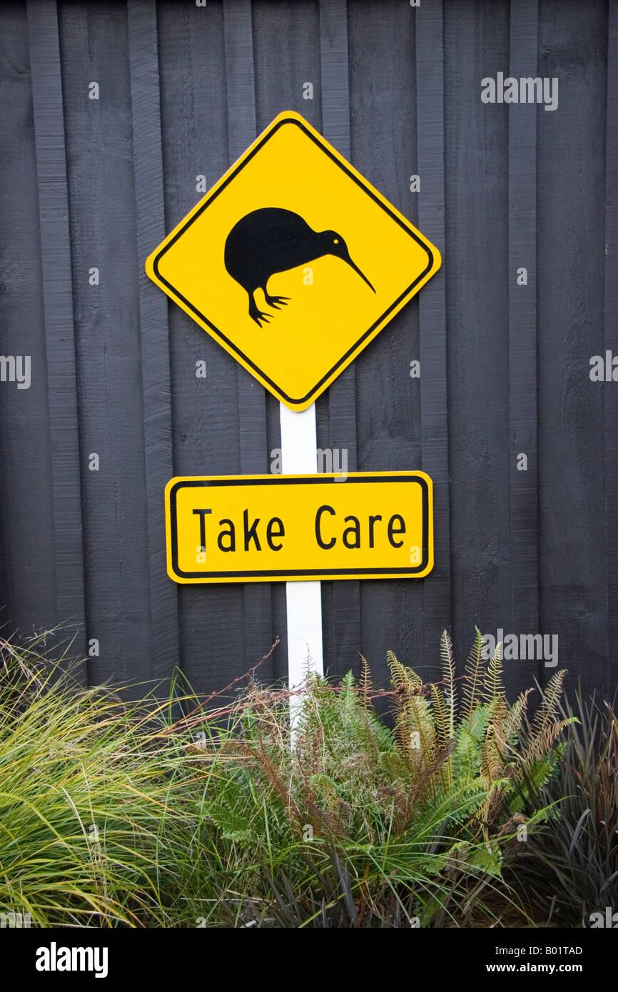 Take care road sign depicting kiwi New Zealand - Stock Image