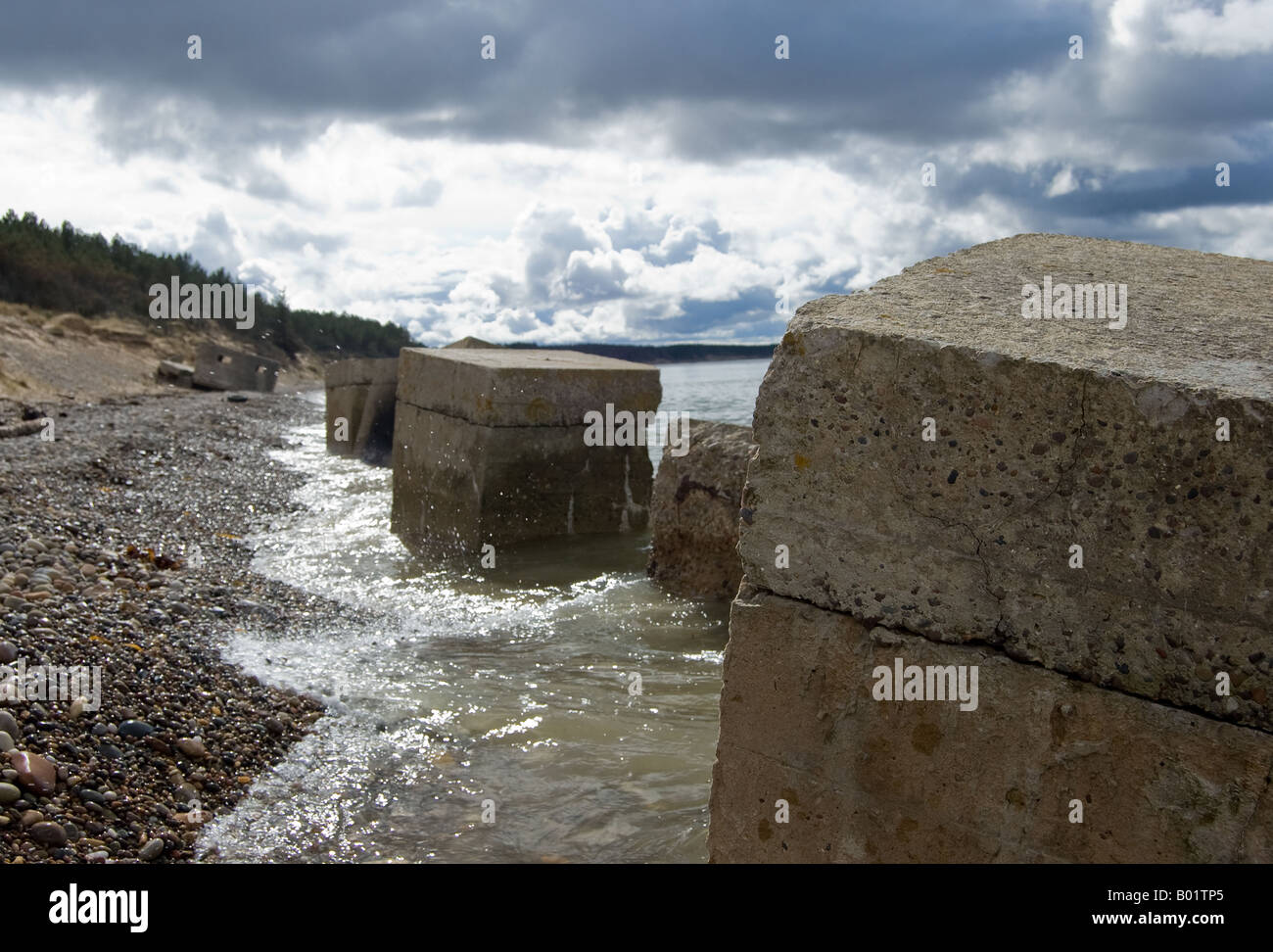Concrete obstacles on Roseisle beach - Stock Image