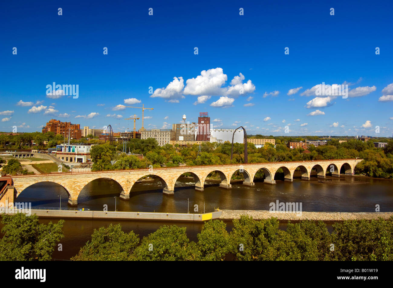 View of the Stone Arch Bridge across the Mississippi River from the Guthrie Theater Minneapolis MN - Stock Image
