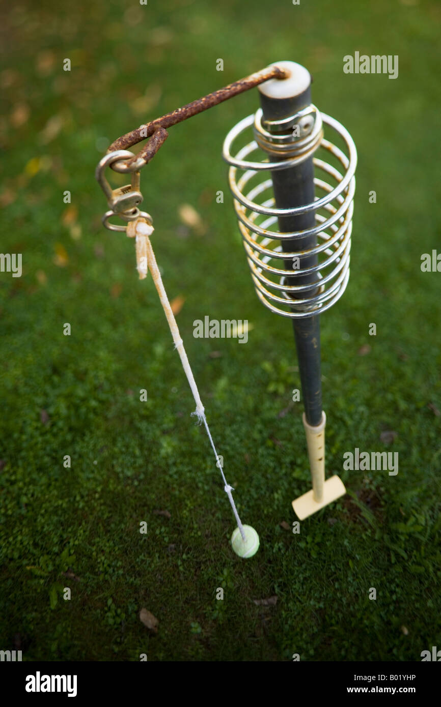 Swingball seen from above all in focus neglected and rusting with frayed string - Stock Image