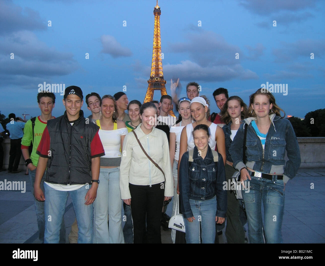 snapshot of school group in front of Eiffel Tower at dusk Paris France Stock Photo