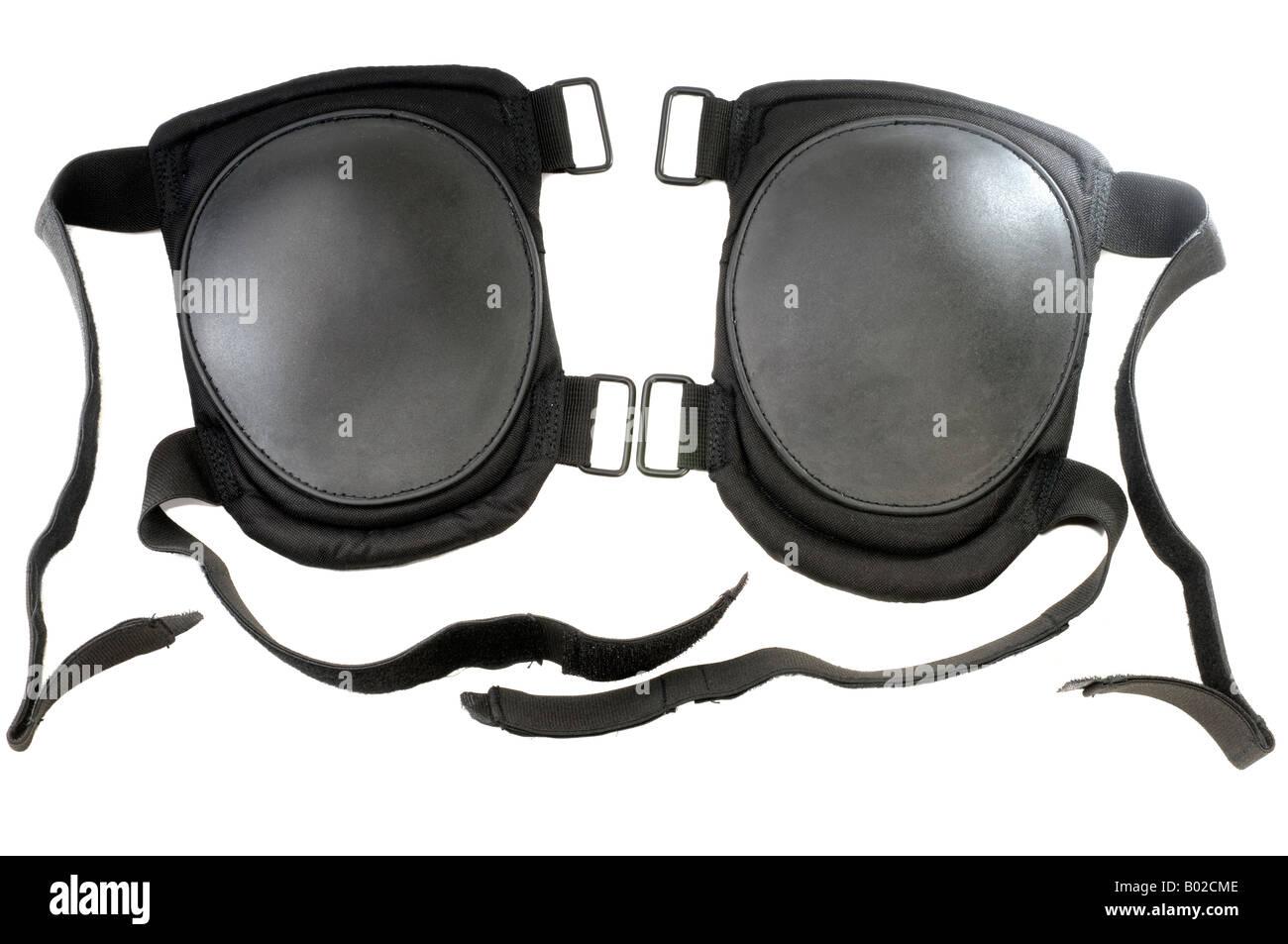 Pair of black velcro fastening knee cap pads - Stock Image