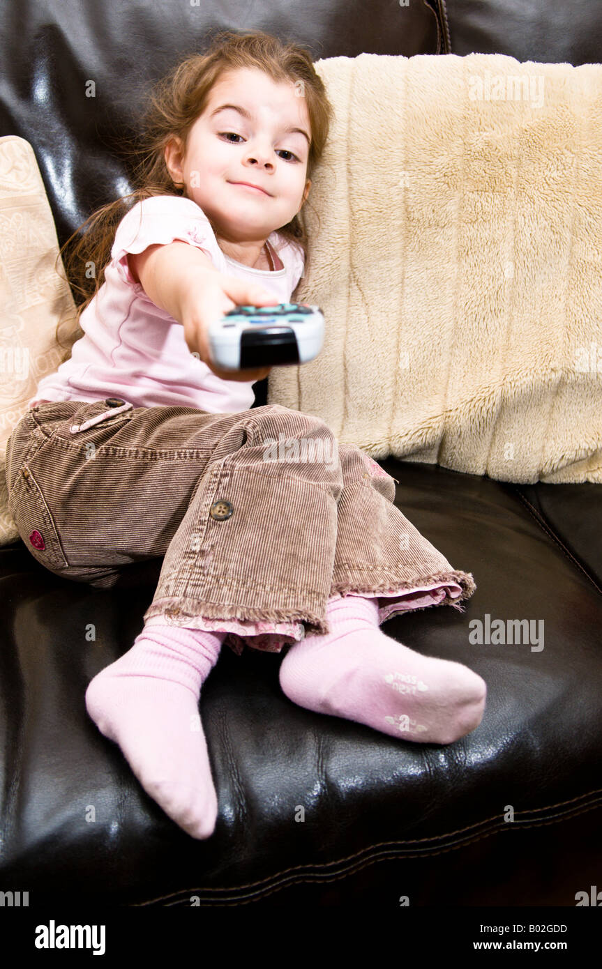 A young girl 4 years old demonstrates the use of a