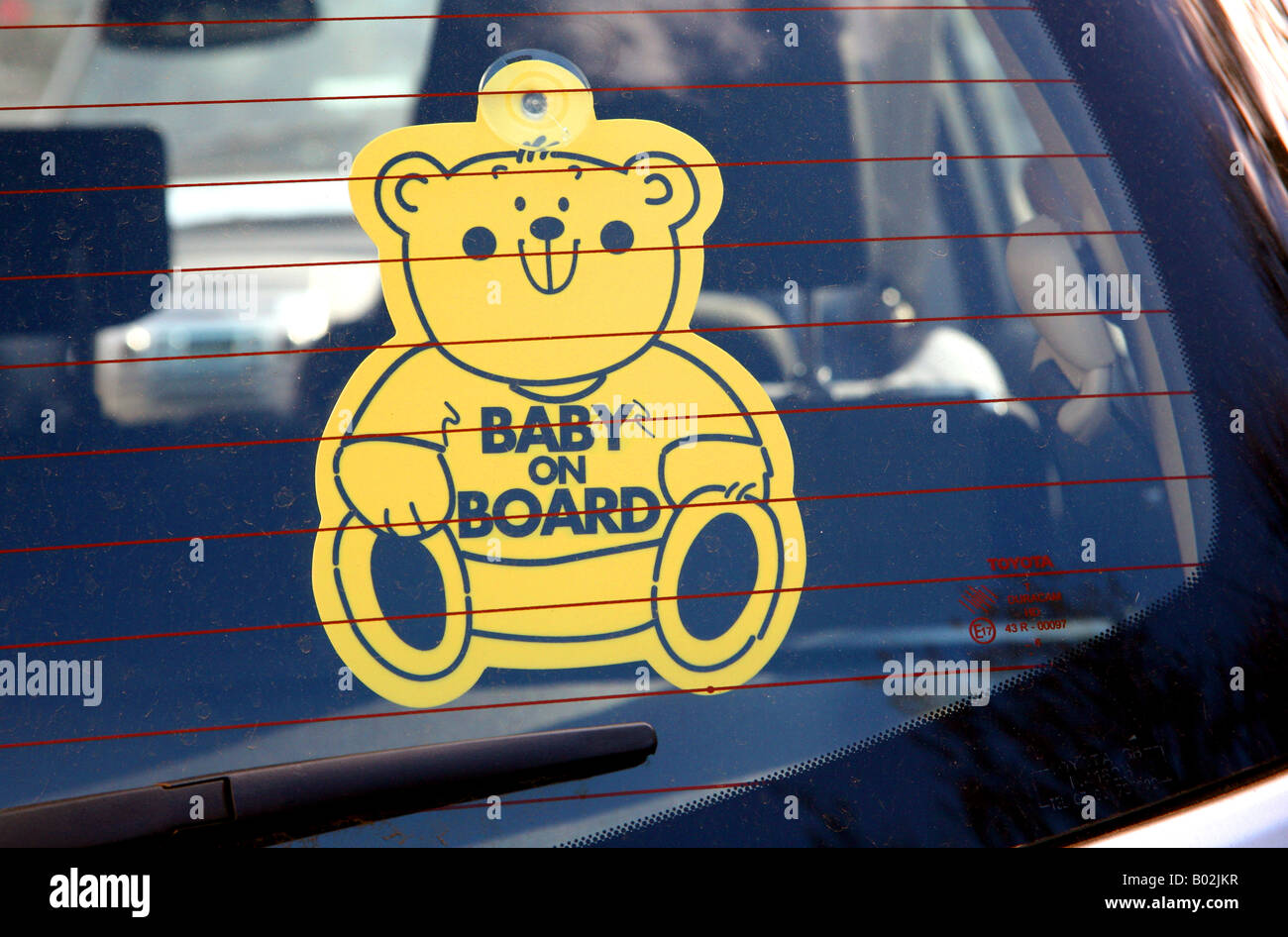 Baby on Board sign in car rear window in London - Stock Image
