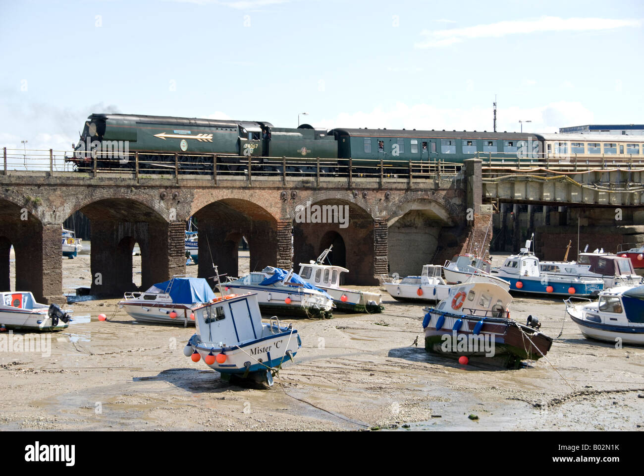 A steam charter train headed by 34067 'Tangmere' leaving Folkestone Harbour. - Stock Image