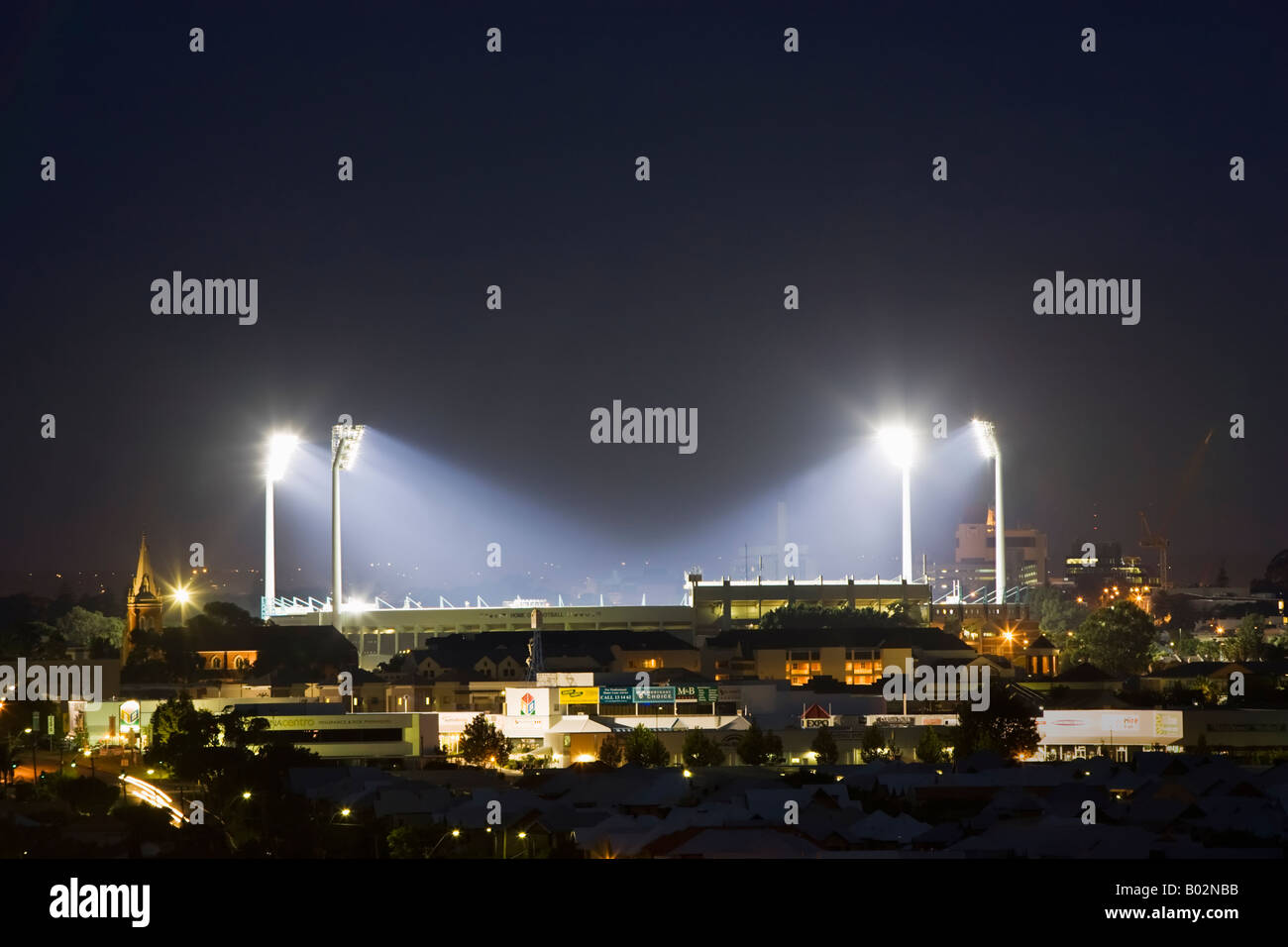 Subiaco Oval stadium in Perth, Western Australia with the floodlights on. - Stock Image