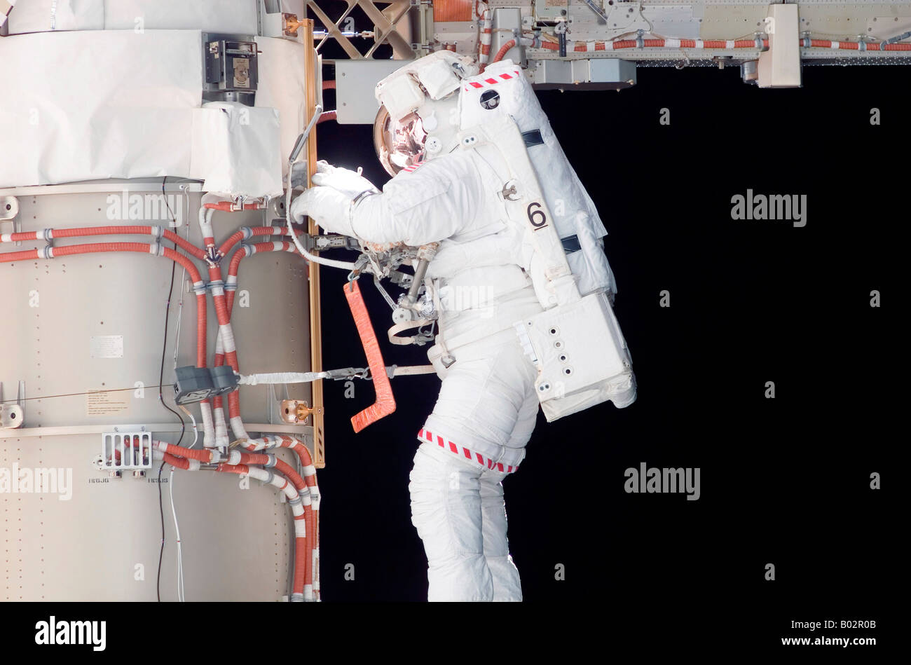 Astronaut partcipating in extravehicular activity. - Stock Image