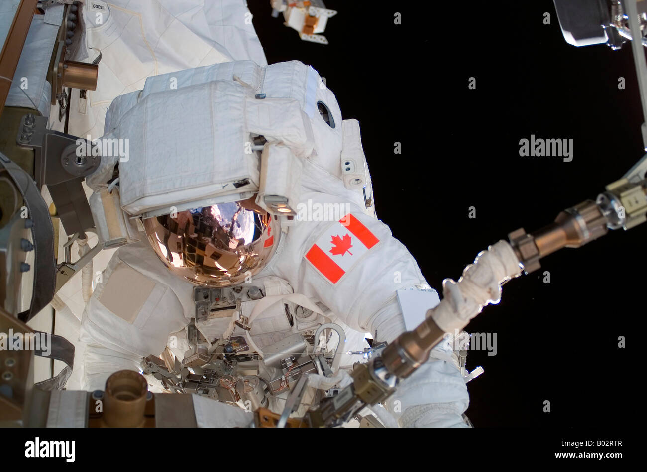 Astronaut participating in extravehicular activity. - Stock Image