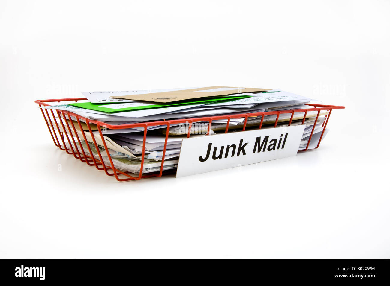 red wire mesh office post tray full of junk mail Stock Photo