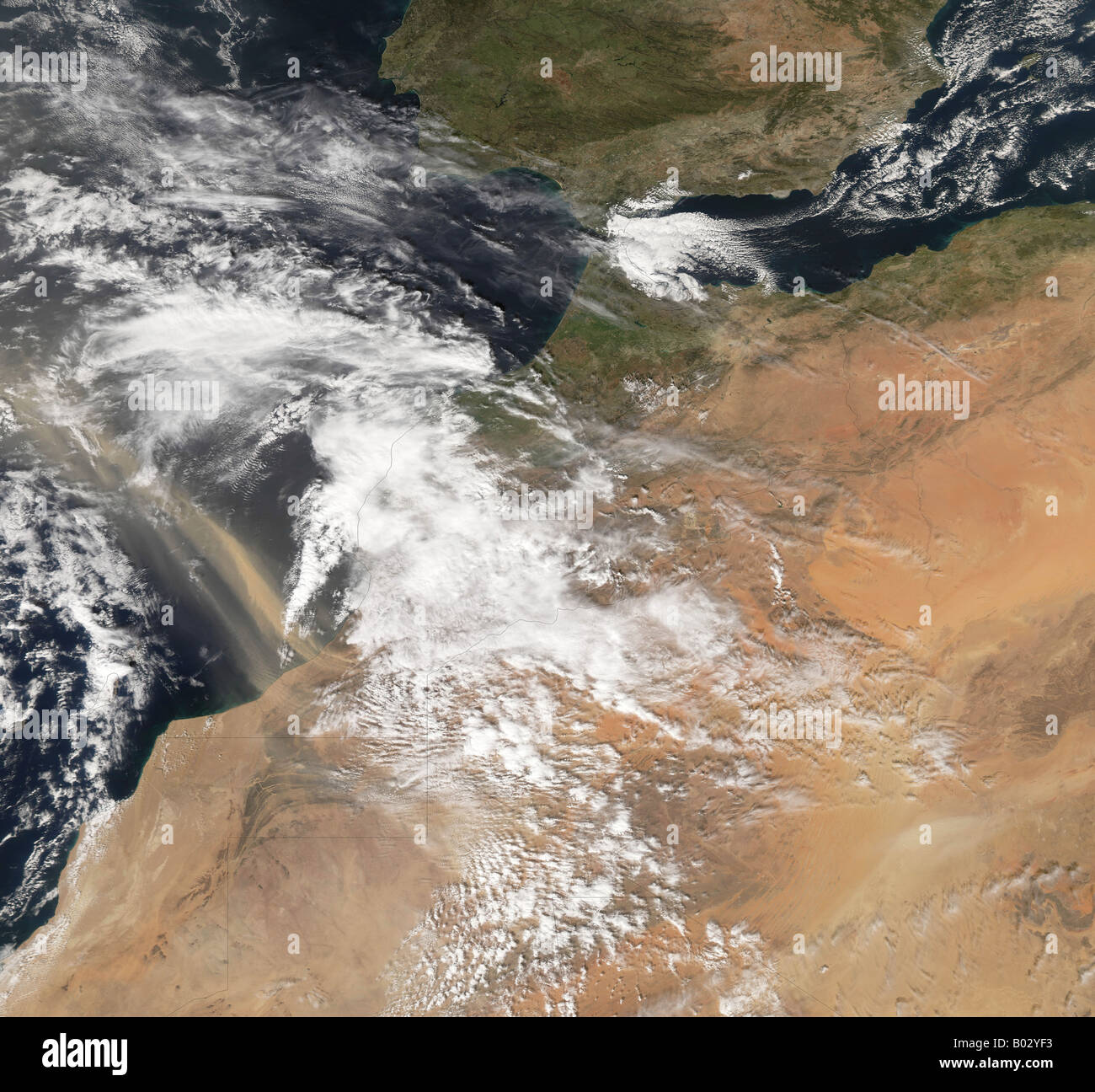Dust plumes blowing off the Moroccan coast. - Stock Image