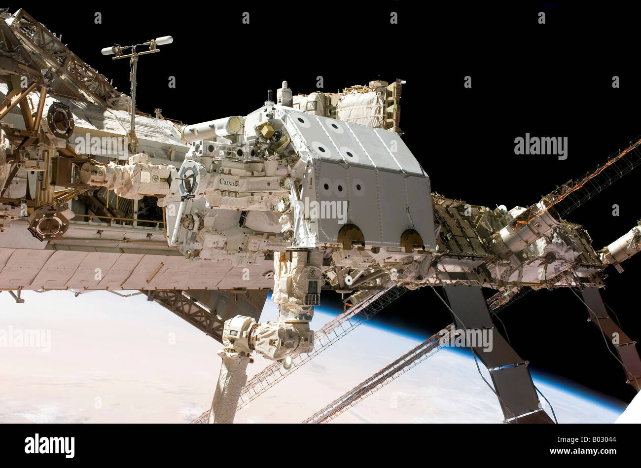 The Canadian-built Dextre robotic system is moved to its place on a station truss. - Stock Image