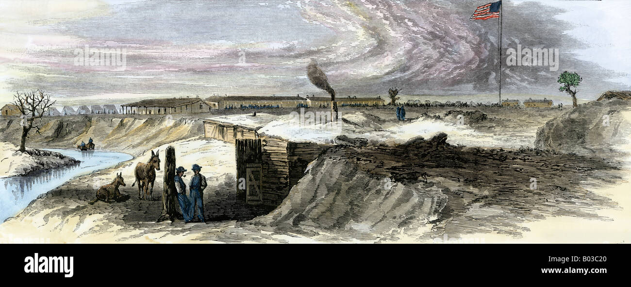 Soldiers digging in for the winter at Fort Larned Kansas 1860s. Hand-colored woodcut - Stock Image