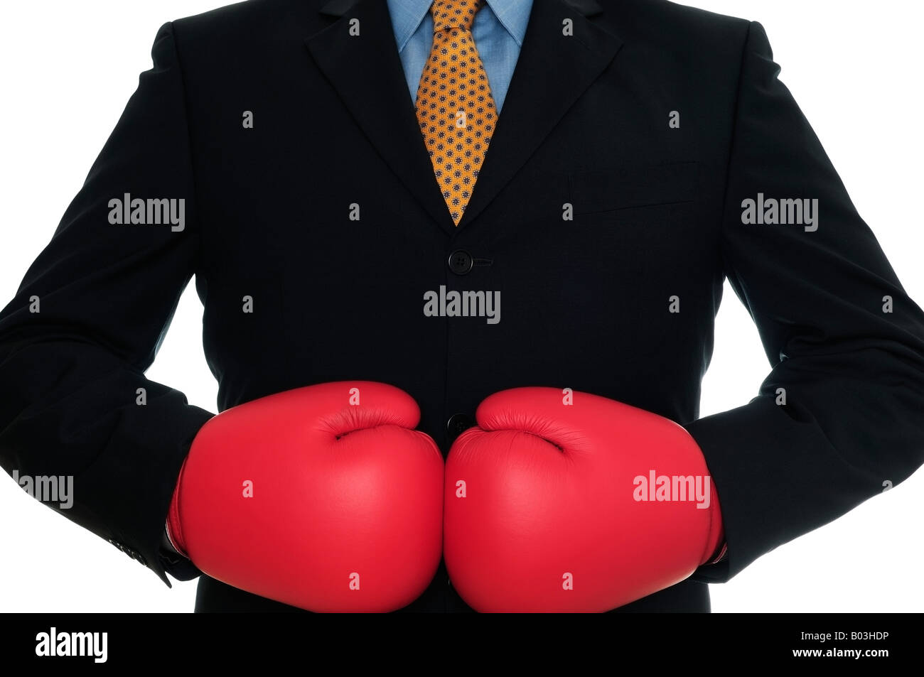Businessman Wearing Boxing Gloves Close Up Against a White Background - Stock Image