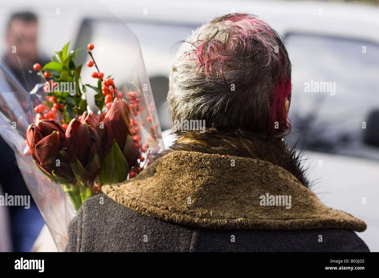 Woman in Columbia Road Flower Market, London - Stock Image