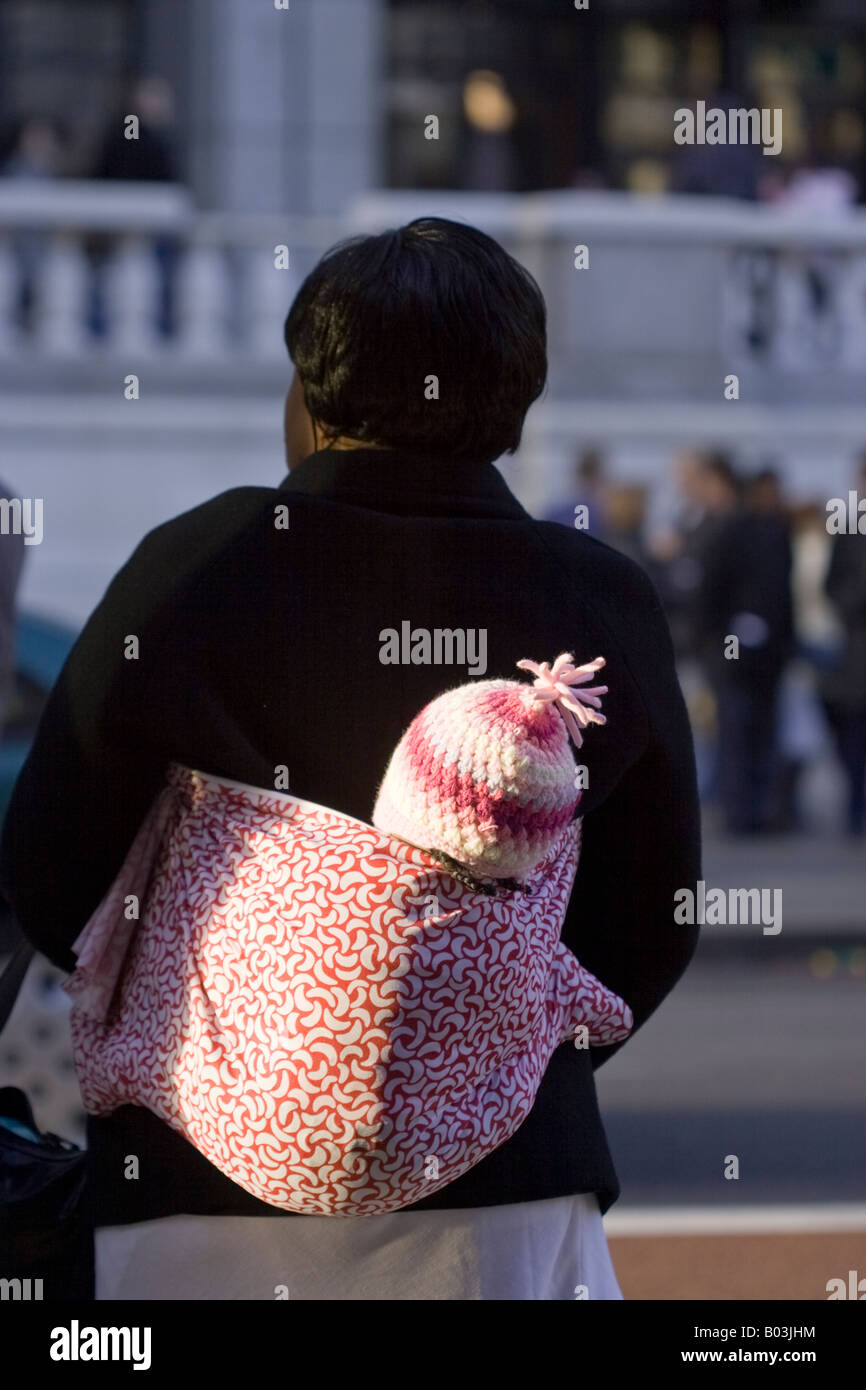 Woman with child. London - Stock Image