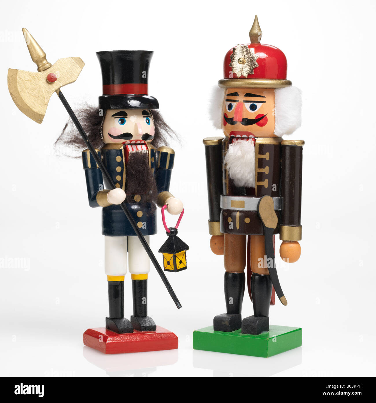 wooden nutcrackers on white background - Stock Image
