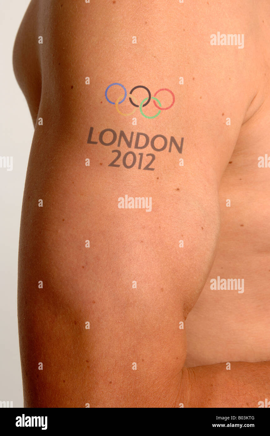 Mans bicep with London olympic games tattoo - Stock Image