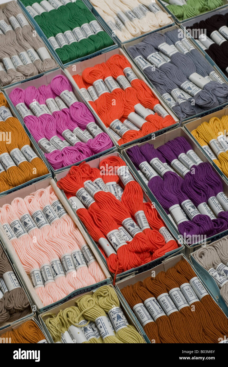 Old boxes of Dollfus-Mieg & Cie needlework cottons, France. - Stock Image