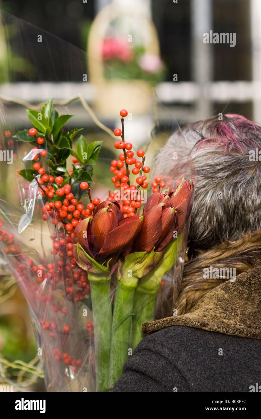 Woman in Columbia Road Flower Market. London - Stock Image