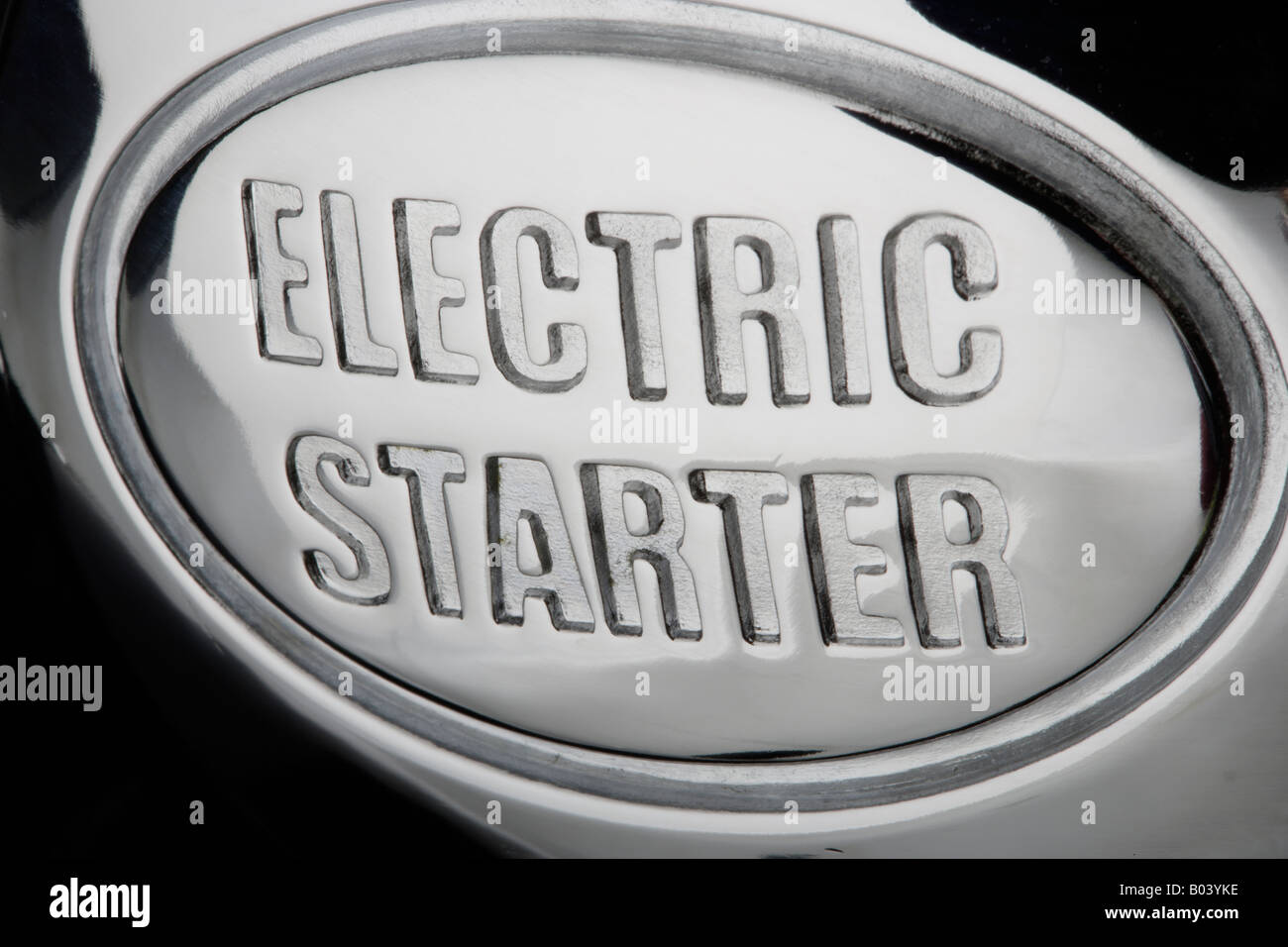 Words Electric Starter embossed in metal - Stock Image