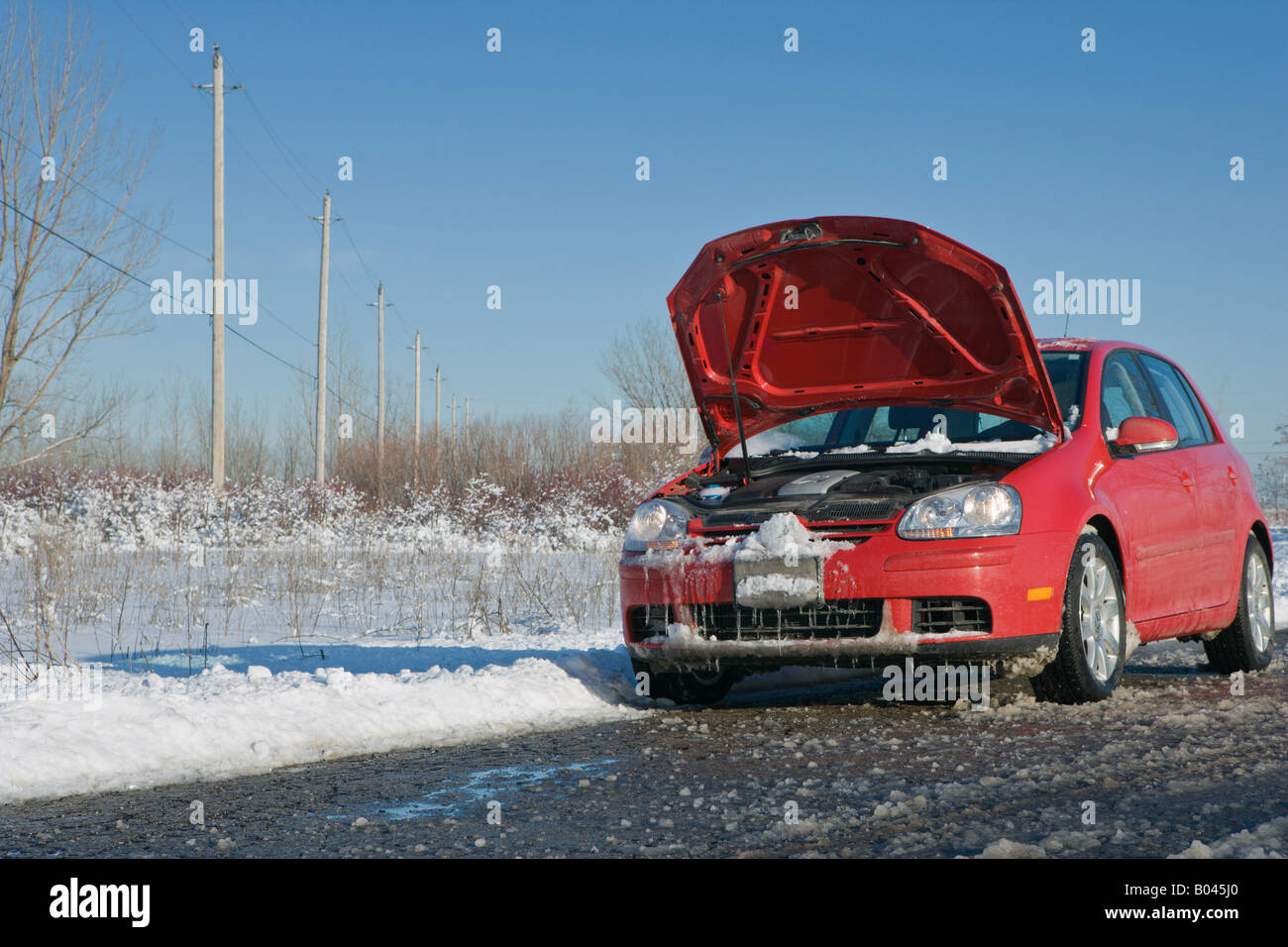 Car with Hood Up in Winter on Country Road Stock Photo