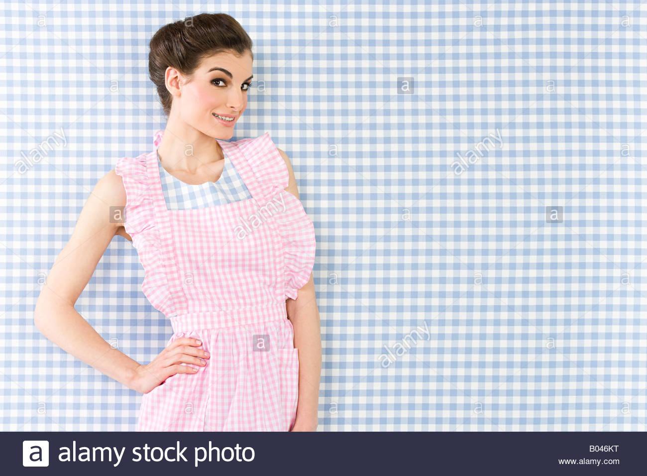 Woman wearing an apron - Stock Image