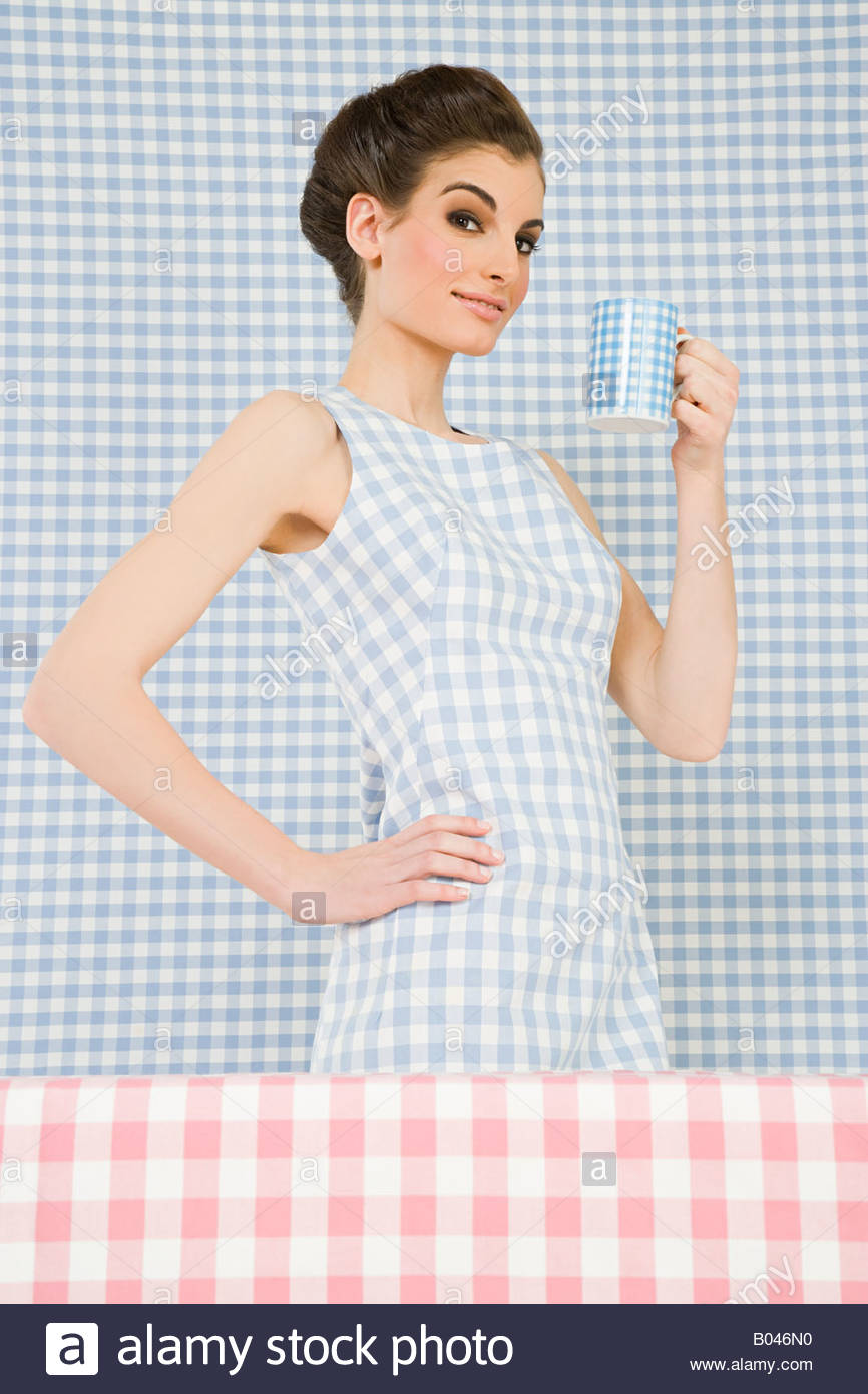 Woman and checker pattern Stock Photo