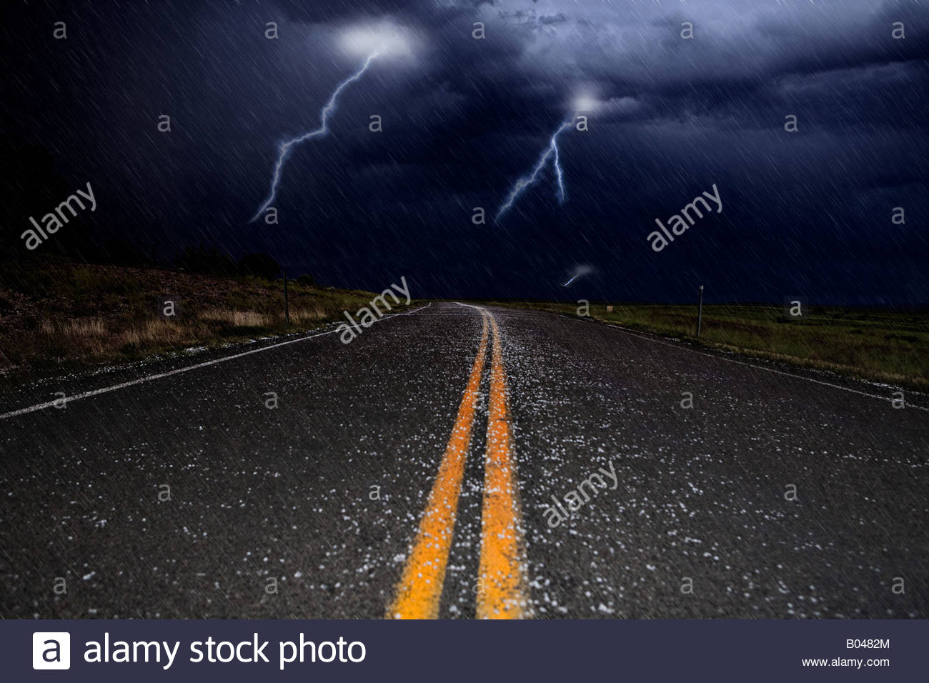 Lightning and hail on a road - Stock Image